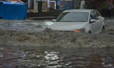 Heavy rains lashed Hyderabad on Monday bringing down temperatures and a respite from the heat. The late evening showers brought life to a standstill, inundated roads making it impossible for commuters to travel smoothly. - Sakshi Post