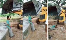 JCB Driver Tries To Move A Man Who Obstructs The Work Using The Loader
