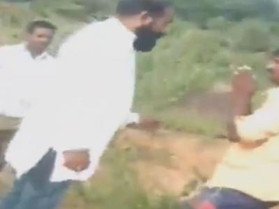 Two Dalit youths being beaten by Bharath Reddy for resisting gravel smuggling