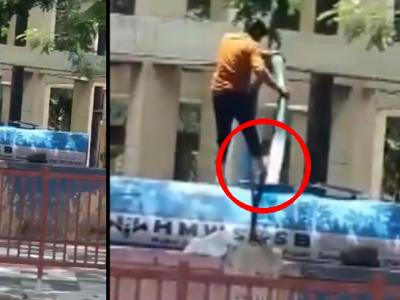 Employee Washes His Legs With Water That Supplies To Public