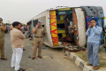 A speeding bus overturned after hitting a road divider in Mainpuri - Sakshi Post