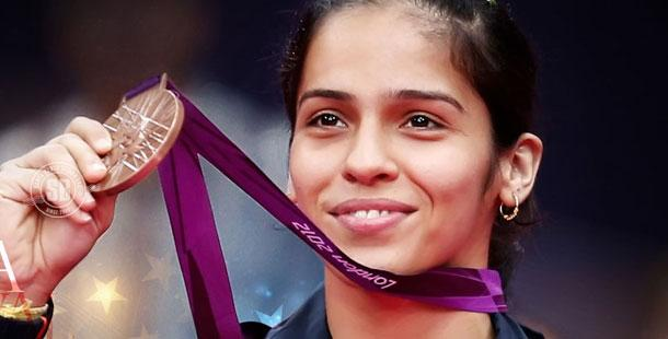 CM honours Saina Nehwal with Rs 50 lakh cheque - Sakshi Post