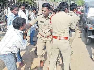 Police Beat Farmers Who Want to Protect Their Lands - Sakshi Post