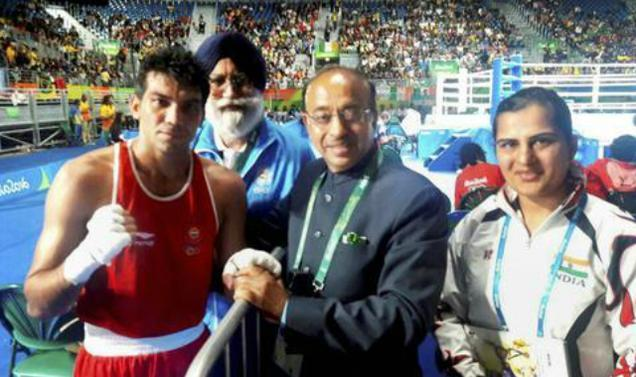 Minister of State for Youth Affairs and Sports (I/C) Vijay Goel greets Indian Boxer Manoj Kumar at Rio de Janeiro on Wednesday. Boxing Coach Shri G.S. Sandhu is also seen. (file photo: PTI) - Sakshi Post