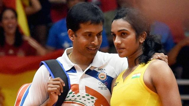 The man behind the victory of PV SIndhu at Rio Olympics: Gopichand with his disciple. - Sakshi Post