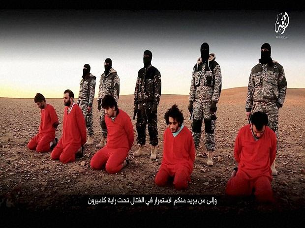 The victims were executed over charges of conspiring against the IS rule in Mosul - Sakshi Post