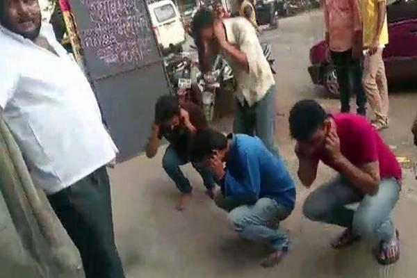 Workers doing sit-ups for refusing to pay donation for the upcoming Ganesh festival - Sakshi Post
