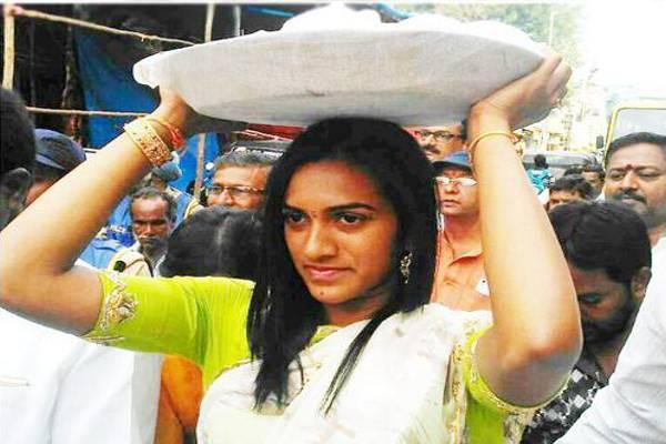 PV Sindhu carried bonam (offerings to the Goddess) on her head and went to the temple in a procession to the accompaniment of traditional nadaswaram. - Sakshi Post