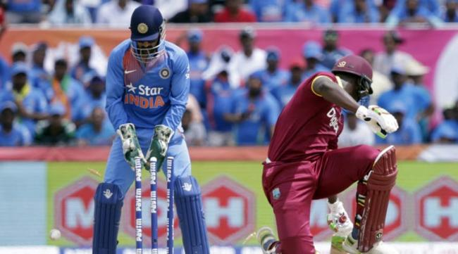 After bowling out the West Indies for 143 in 19.4 overs, India were 15/0 in two overs when the dark clouds hovering over Lauderhill opened up, interrupting the play - Sakshi Post