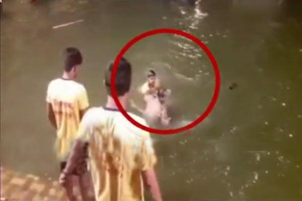 One of the four youths even climbed on the SI and tried to push him into water. - Sakshi Post