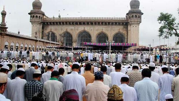 The devout offering prayers at Mecca Masjid near Charminar in Hyderabad on Tuesday. - Sakshi Post