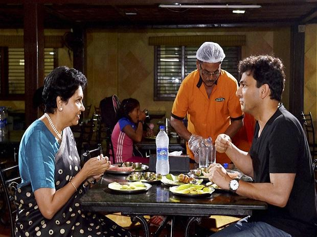 PepsiCo CEO Indra Nooyi with the company's nutrition ambassador star chef Vikas Khanna at an eatery in Chennai. - Sakshi Post