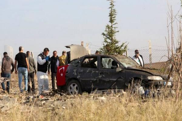 Forensic experts examining the car used by suicide bombers. - Sakshi Post