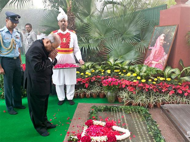 President Pranab Mukherjee paying floral tributes at the site where former prime minister Indira Gandhi was assassinated, in New Delhi on Monday. - Sakshi Post