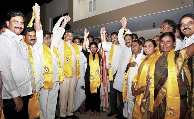 AP chief minister N Chandrababu Naidu with defected YSRCP MLAs after they formally joined the TDP. - Sakshi Post