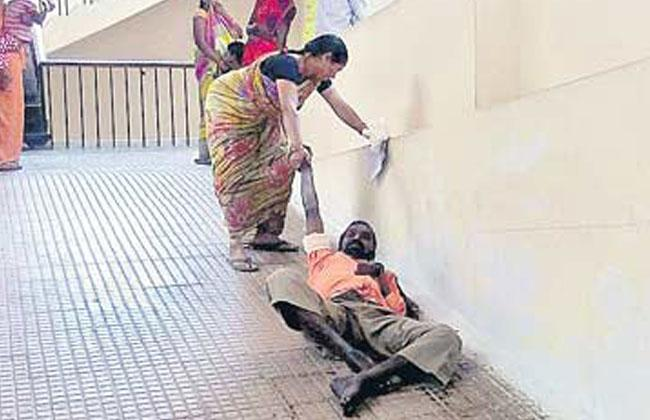 Patient Srinivasachary being dragged by wife to first floor for doctor consultation - Sakshi Post