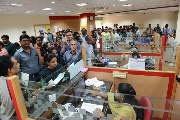 People queue up inside a bank to exchange their old Rs 1000 and 500 notes. - Sakshi Post