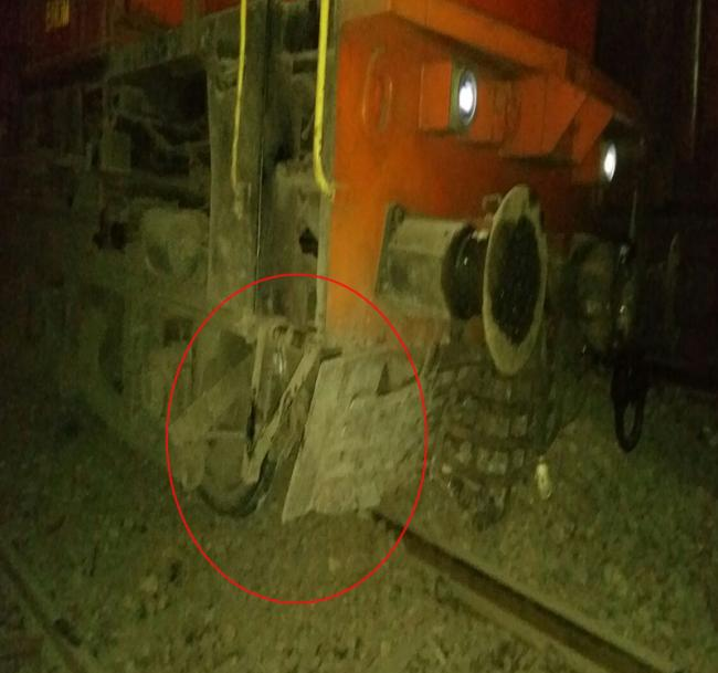 The engine of the ill-fated train standing off the track following the derailment. - Sakshi Post