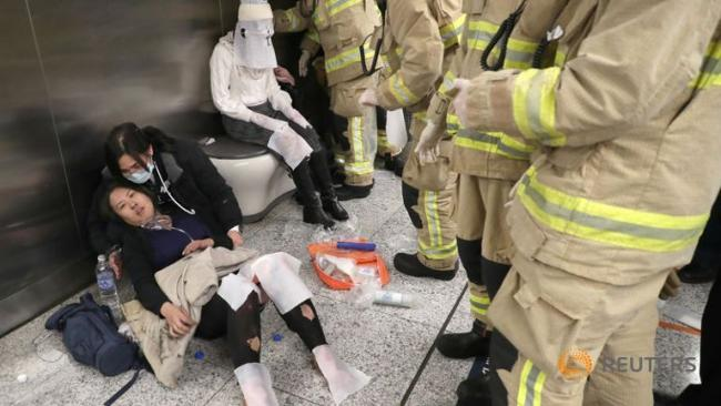 Video footage showed chaos on the platform of the packed Tsim Sha Tsui station - Sakshi Post