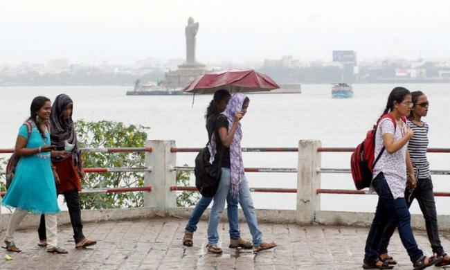 The people reeling under intense heat got some relief after showers on Saturday and Sunday - Sakshi Post