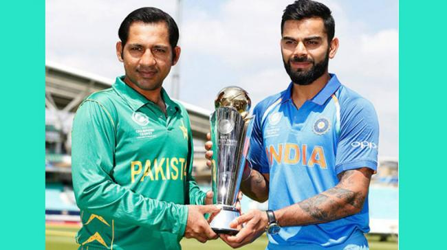 Indian skipper Virat Kohli and his Pakistani counterpart Sarfraz Ahmed posed with the trophy ahead of the final match of the ICC Champions Trophy 2017 due on Sunday. - Sakshi Post