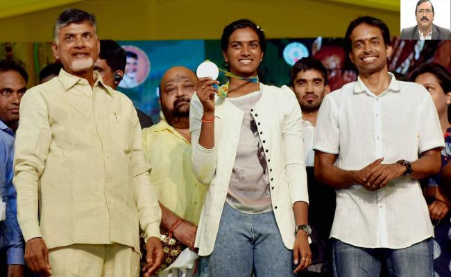 Chief minister N Chandrababu Naidu felicitating PV Sindhu after her Olympic victory. Also seen is coach Pullela Gopichand. (file picture) - Sakshi Post