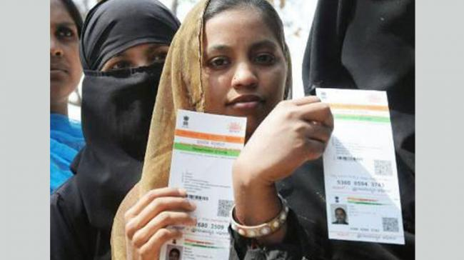 Aadhaar is made mandatory for most of the government schemes - Sakshi Post