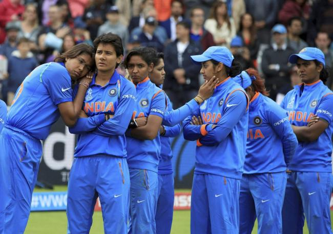 India players stand dejected prior to receiving their runners-up medals after losing the CC Women's World Cup final match against England, at Lord's, in London, Sunday. - Sakshi Post