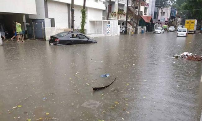 The rains wreaked havoc across the city, crippling normal life, flooding roads and houses in many localities - Sakshi Post