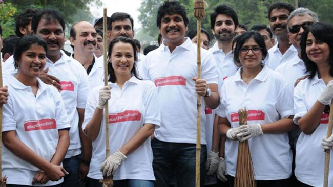 Besides sweeping the road, the founder of Blue Cross also repaired the potholes in the colony (File photo) - Sakshi Post