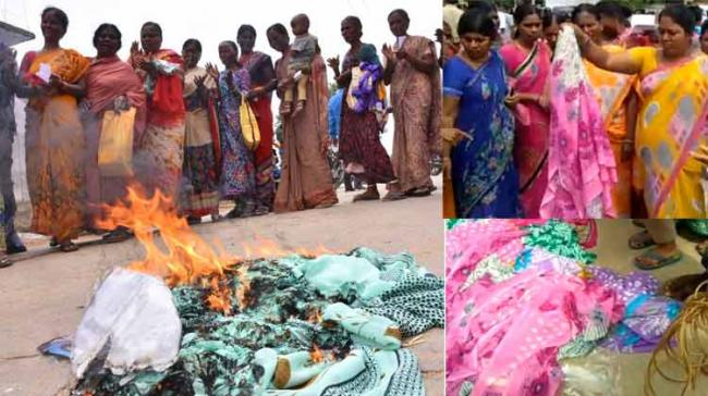 The beneficiaries got angry and questioned the officials about the poor quality of sarees. Later, they protested by burning the sarees on road. - Sakshi Post