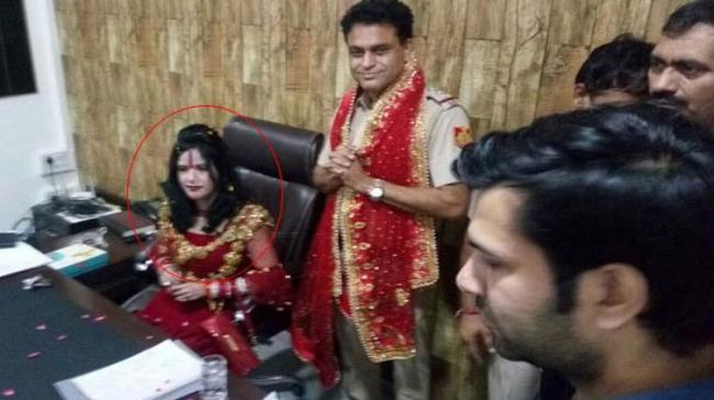 Radhe maa sits on Station House Officer's chair at Delhi police station - Sakshi Post