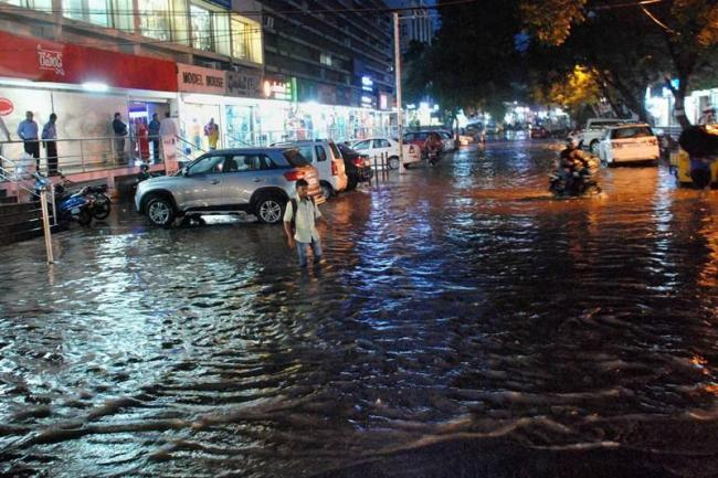 Heavy downpour on Monday evening brought traffic to a standstill while roads were inundated with water. - Sakshi Post