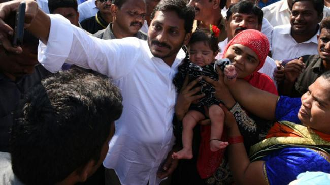 YS Jagan clicks a selfie with a mother holding her child at VN Pally in YSR Kadapa district on Day 3 of PrajaSankalpaYatra on Wednesday. - Sakshi Post