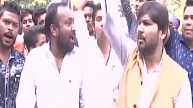Congress party workers celebrate the victory in Chitrakoot by-poll - Sakshi Post