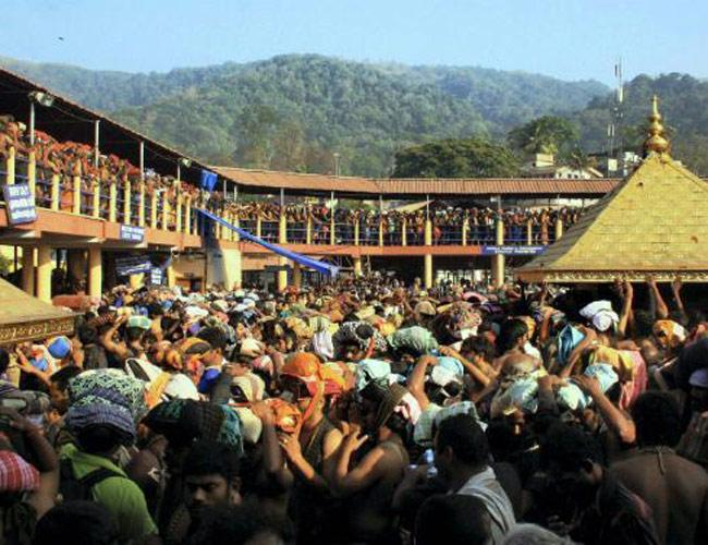 The two-month-long famed Sabarimala pilgrimage season opened in the wee hours of Thursday as thousands stood in queue to have the first darshan. - Sakshi Post
