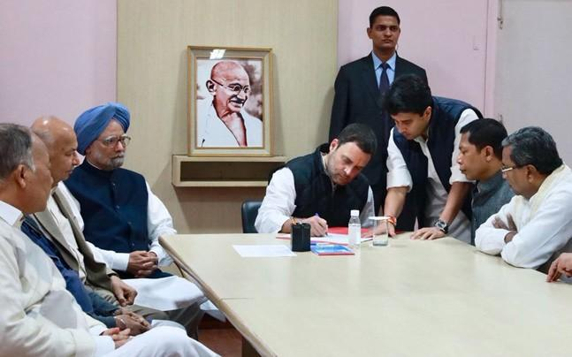 Congress President Sonia Gandhi on Monday signed as the first proposer on the first nomination paper submitted for the election  party Vice President Rahul Gandhi to the post of party chief. - Sakshi Post