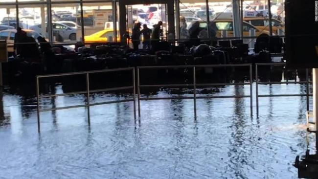 The Terminal 4 of New York's John F Kennedy International Airport have been shut down after flooding due to a water main break at the baggage - Sakshi Post