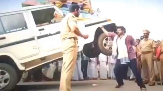 A fan shared a video clip from Balayya's latest film Jaisimha showing the actor performing a gravity defying stunt lifting a Mahindra Bolero with one hand - Sakshi Post