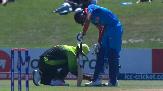 The picture showing a Pak fieldsman tying the shoelaces of an Indian Batsman went viral on social media - Sakshi Post