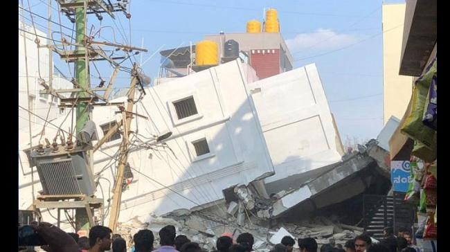 It is learnt that the building was four-storyed and five year old. The quality of construction is said to be bad. - Sakshi Post