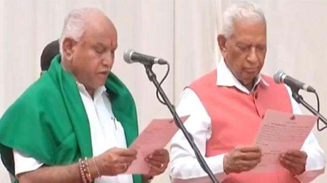 BS Yeddyurappa was administered the oath of office and secrecy by Governor Vajubhai Vala at a ceremony at Raj Bhavan - Sakshi Post