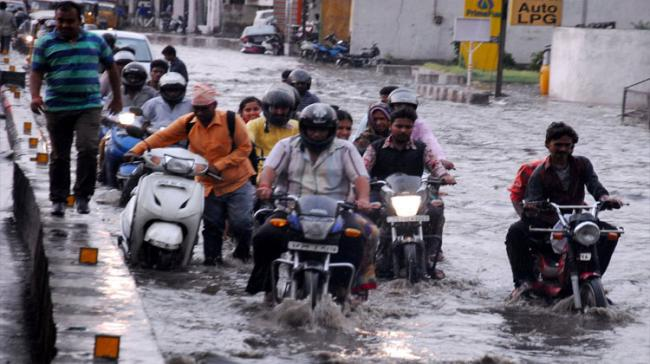 As many of the areas were waterlogged, motorists and commuters faced difficulties after a heavy downpour - Sakshi Post