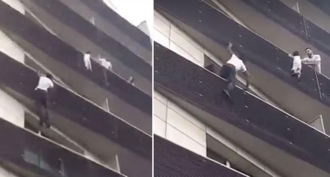 In less than a minute, he pulls himself from balcony to balcony and grabs the four-year-old as a neighbour tries to hold the child from an adjoining flat. - Sakshi Post