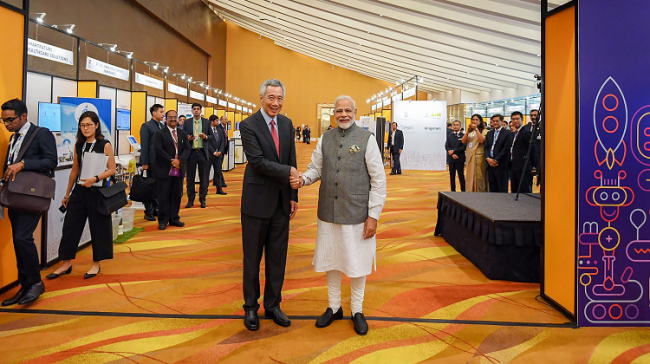 Prime Minister Narendra Modi shakes hands with Singapore Prime Minister Lee Hsien Loong - Sakshi Post
