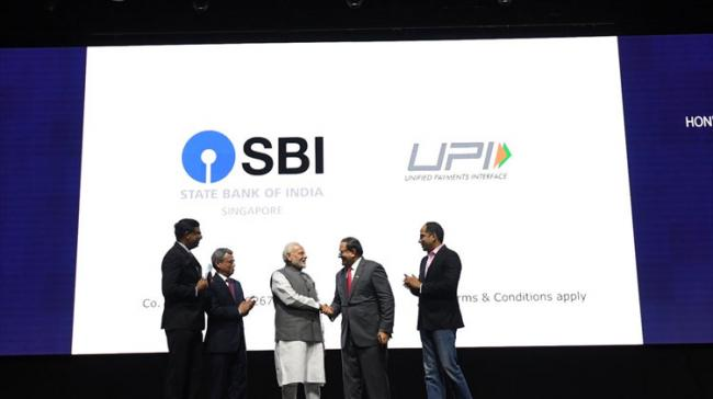 Addressing a business and community event, Modi described the relationship between India and Singapore as our heritage - Sakshi Post