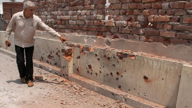 Civilian showing the damage done to it house by Pakistani shelling - Sakshi Post