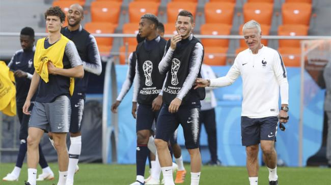 France headcoach Didier Deschamps jokes with Lucas Hernandez during Frances official training at the eve of the group C match between France and Peru at the 2018 soccer World Cup in Yekaterinburg, Russia  - Sakshi Post