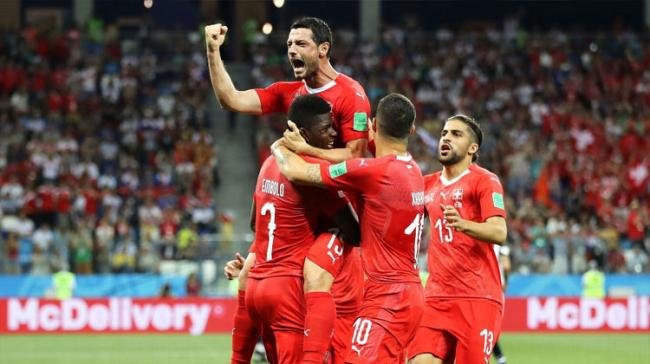 The result meant Switzerland finished second in the group behind Brazil with five points - Sakshi Post