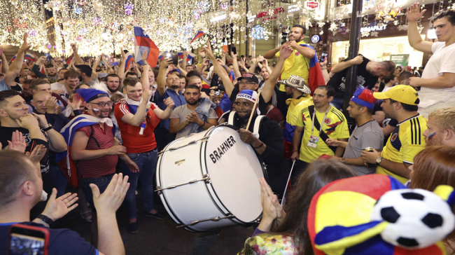 Russian fans near Red Square, Moscow celebrate their victory over Spain in the last 16 at the 2018 FIFA World Cup in Moscow - Sakshi Post